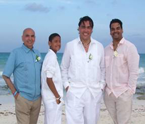 Groom and his family embracing the cool and sophisticated Guayabera look for their Beach Wedding