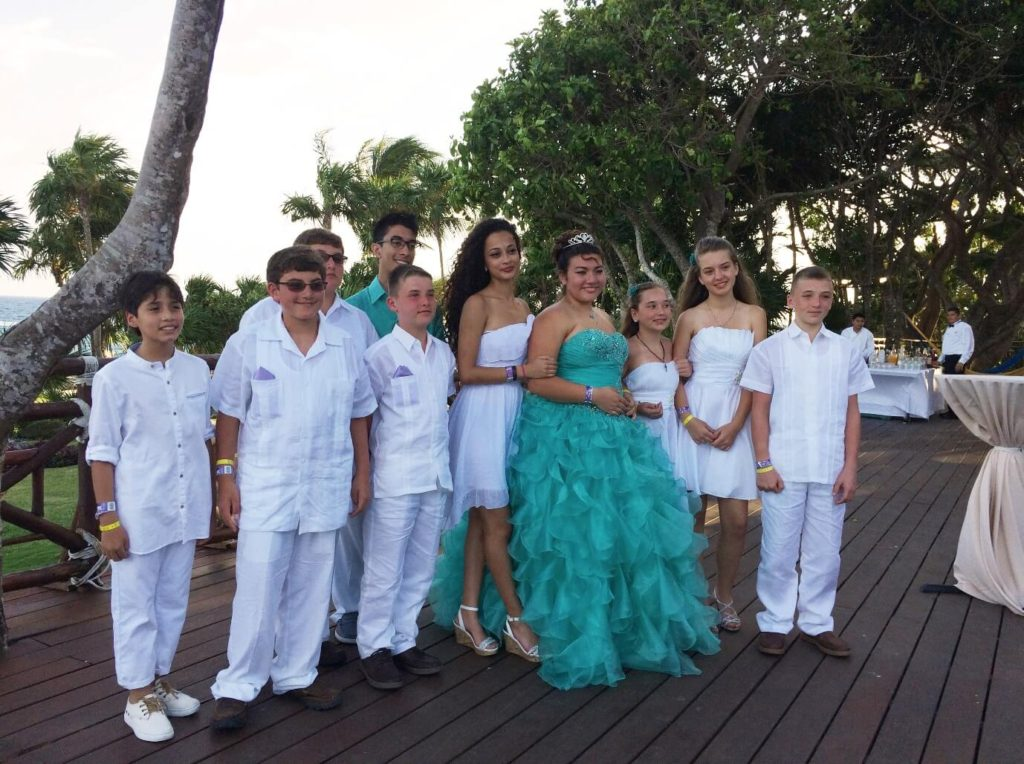 The 15 year-old Quinceañera at her Quinceañera party along with her theme coordinated Damas and Chambelanes