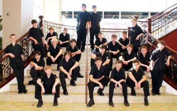 Gold Standard High School's Music Band in coordinated black outfits