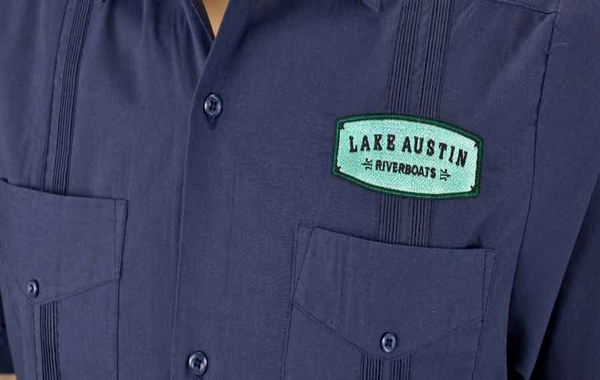 Guayabera embossed with a specified 'Lake Austin' company logo